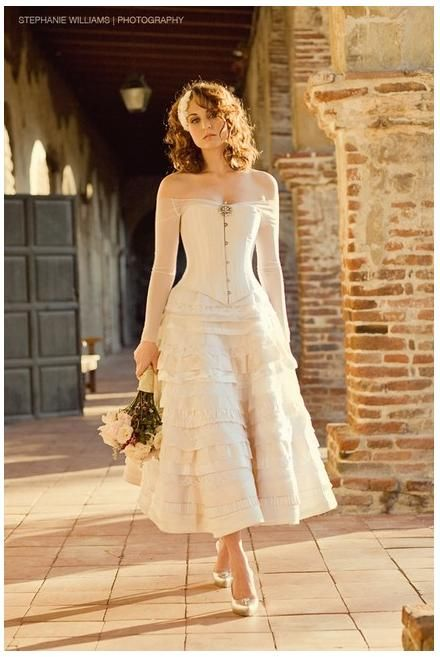 Stunning ivory t-length wedding dress with beautiful corset and sheer sleeves