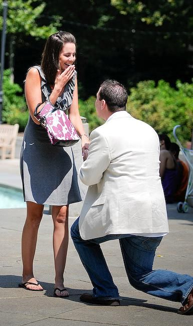 Groom-to-be on one knee, asks girlfriend to marry him outside in park