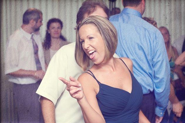 The bridesmaids, in blue spaghetti strap dresses, had fun dancing.