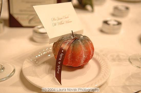 Fall weddings: attach your guests' escort cards to a mini pumpkin