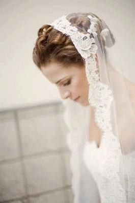Beautiful white lace mantilla veil