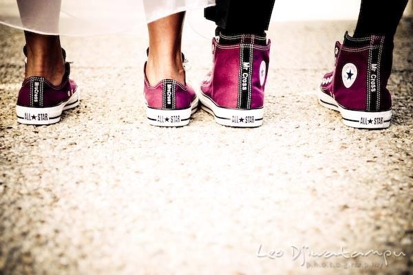Sporty bride and groom don matching fuschia and black converse, personalized with Mr. and Mrs.