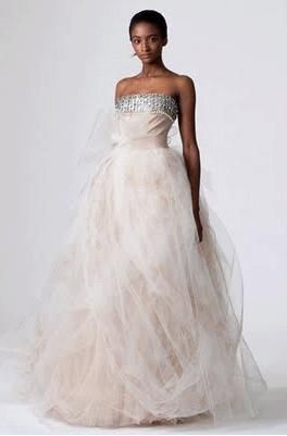 Strapless wedding dress swathed in white tulle over pink rose appliques