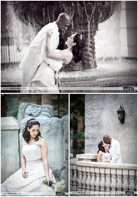 The groom's white suit looks cool and elegant next to the fountain as he kisses his bride in her whi