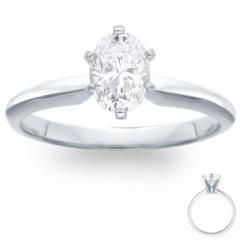 This 18k white gold solitaire engagement ring is actually, not from Zales.