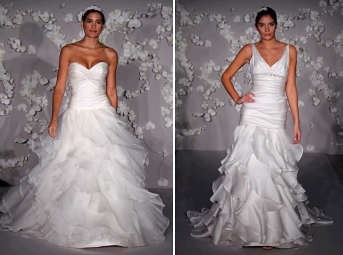 White wedding dresses from Jim Hjelm- plunging sweetheart neckline, cascading skirt