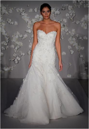 Ivory hand beaded wedding dress with a tulle trumpet skirt and sweetheart