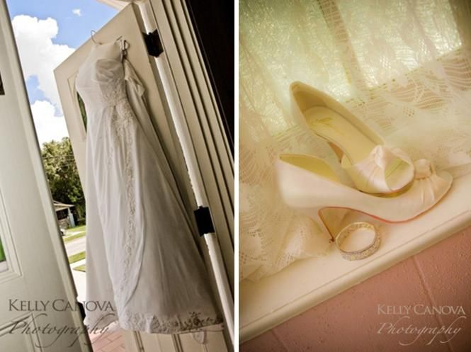 White strapless wedding dress hangs on door; ivory peep toe bridal heels sit in window