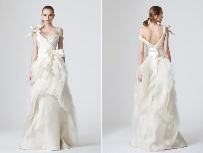 Avant garde Vera Wang white wedding dress with assymetrical bow details and low, v back