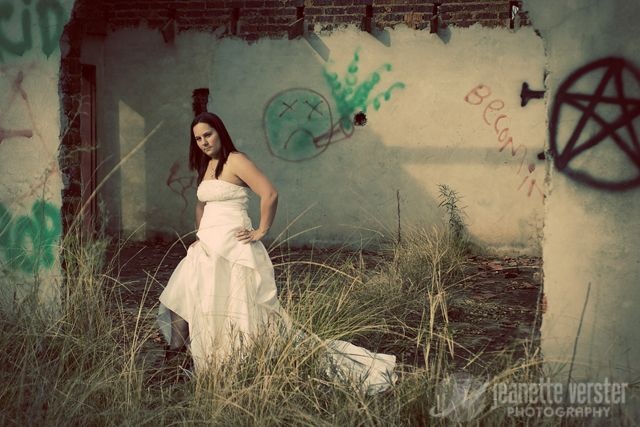 As unhappy as this bride looks, she's probably thrilled with this beautiful trash the dress photogra