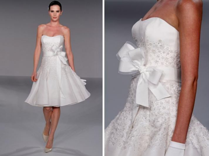 Knee-length strapless wedding reception dress with floral applique and oversized bow