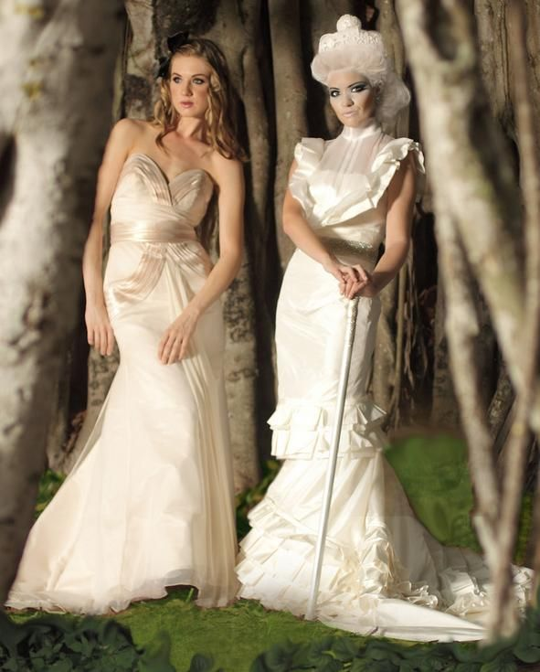 Couture cream and ivory wedding dresses with pleating detail, sheer turtle neck, and poufy cap sleev
