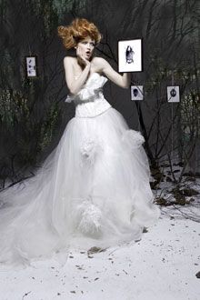 Romantic winter wedding wedding dress with flower applique and feathers