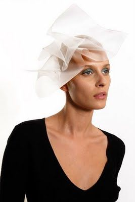This poufy white wedding veil by Noel Stewart might overtake a smaller bride.