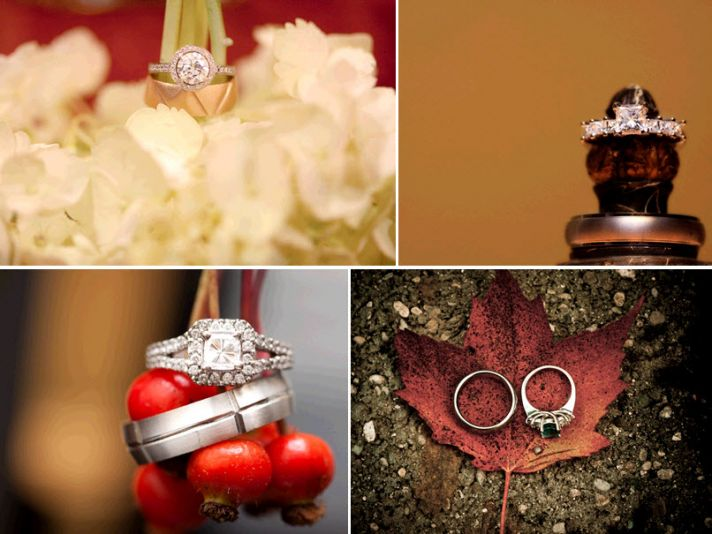 Engagement and wedding rings placed atop red berries, white flowers, and fall leaves… Stunning!