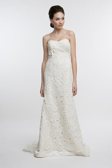 English laser-cut lace fabric was used to create this gorgeous, classic Amy Kuschel wedding dress