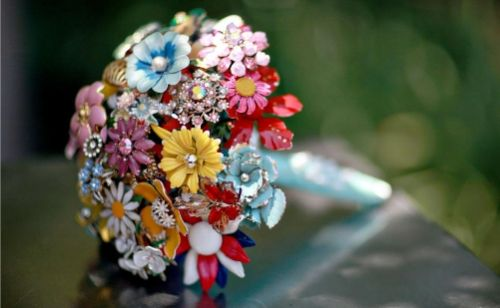 Vibrant, colorful brooch bouquet made from vintage brooches- a great eco-chic alternative to fresh c