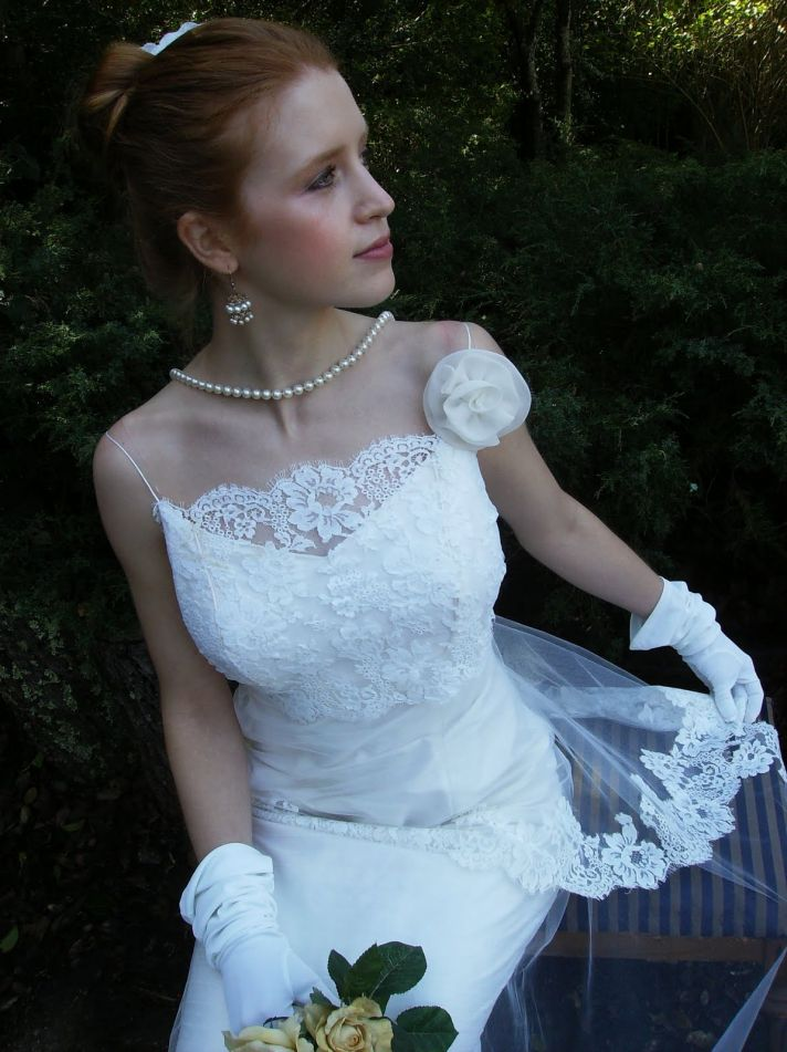 Spaghetti strap lace wedding dress with floral rosette applique