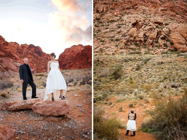 Bride and groom, in full wedding garb, stand atop canyon rocks in Red Rock Canyon