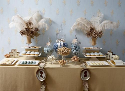 Beautiful vintage-inspired dessert table with ivory feathers and gold and light blue accents