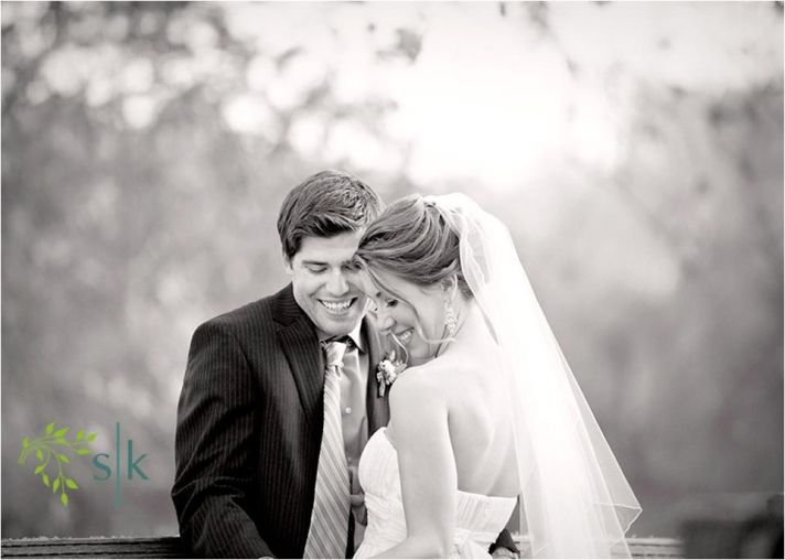 Lovely young bride (in white sheath wedding dress and mid-length veil) and groom will cherish this w