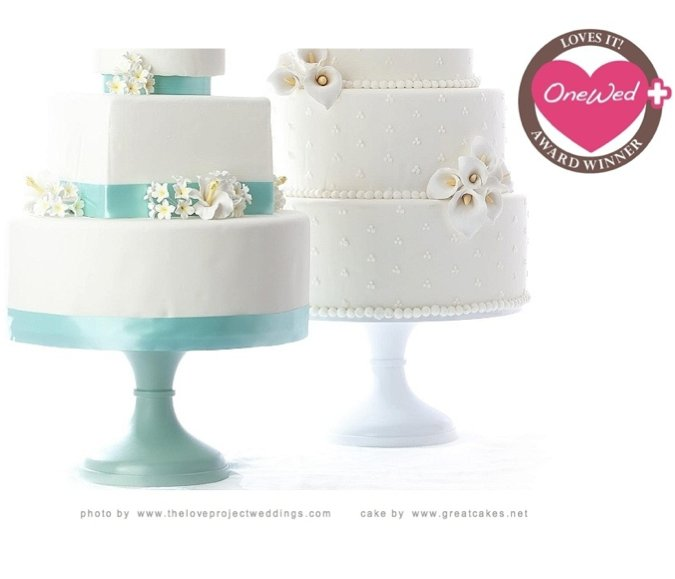 OneWed loves cake stands in a variety of colors, especially when topped with a delicious white weddi