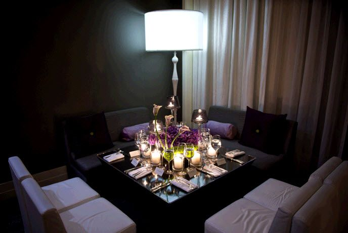 Intimate loungy wedding reception setup black white grey and deep purple