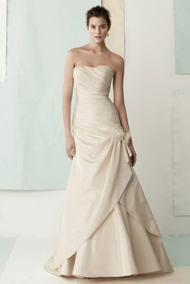 Classic cream strapless a-line wedding dress, gathered on the side with a large fabric flower