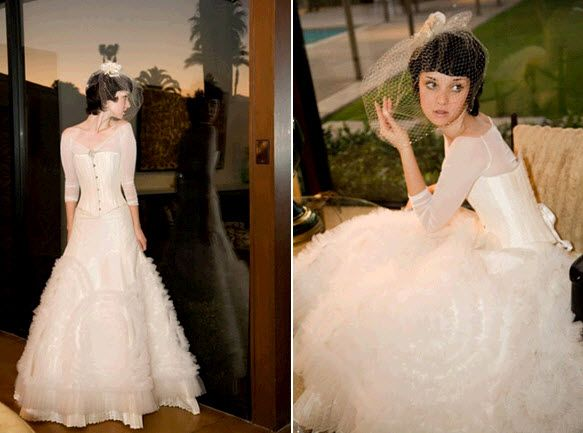 Long sleeved corseted wedding dress by Joan Shum