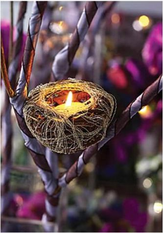 Faux bird 39s nest with white votive candle placed in branches covered with