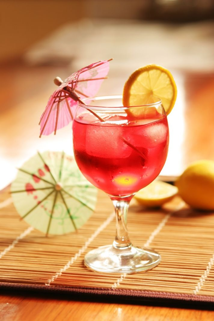 This pretty pink cocktail with it's umbrella is perfect to serve at a bachelorette party.