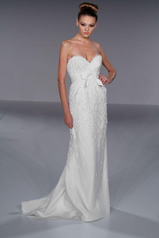 Romantic white sheath style wedding dress with deep sweetheart neckline