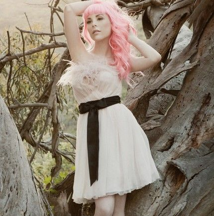 Edgy pink-haired bride wears soft pink flirty frock with black sash