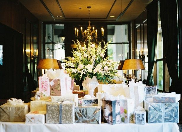 These wedding gifts are elegantly wrapped and displayed on a wedding gift table.