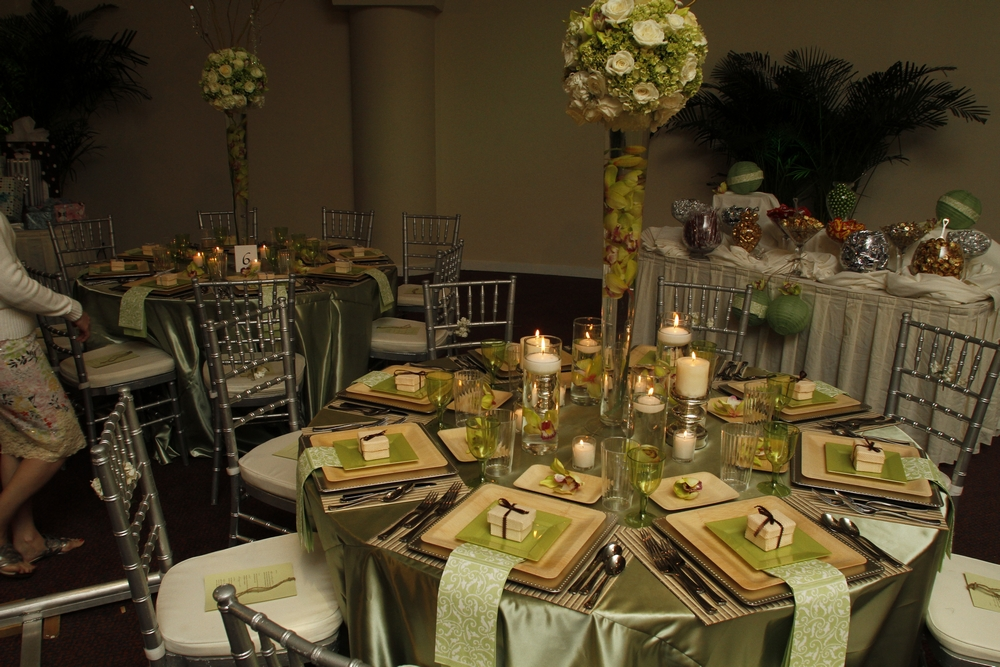 The enchanted garden wedding reception with a sage green and natural wood