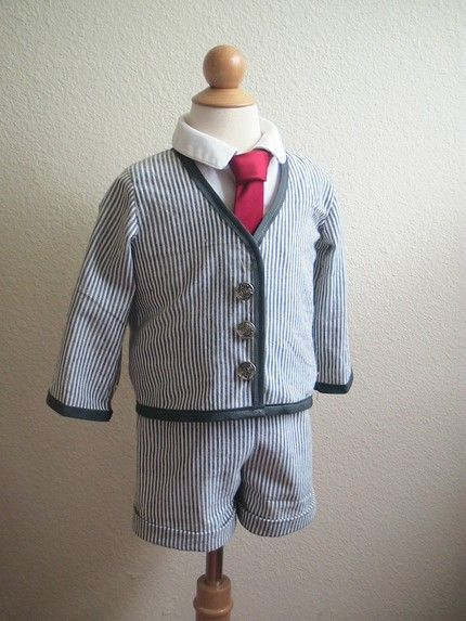 Adorable blue and white searsucker suit with red tie for ring bearer