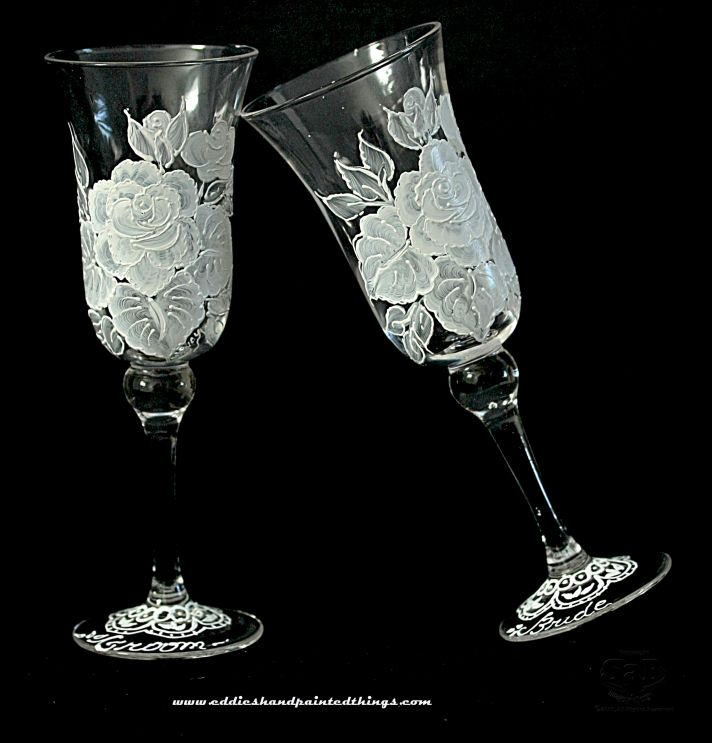 Perfect for the vintage bride, these hand painted toasting flutes feature a white rose and lace desi