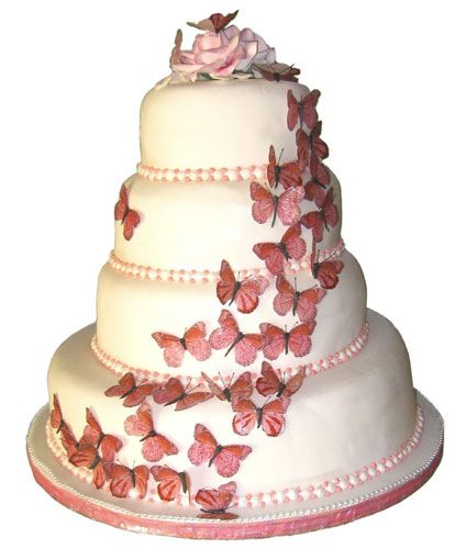 This four tiered white wedding cake is decorated with pink butterflies, one of the top wedding theme
