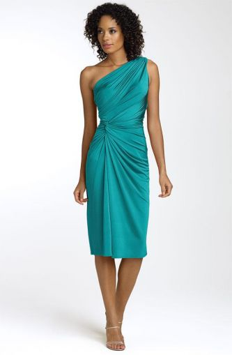 This teal oneshoulder bridesmaids dress that cinches at the waist is a