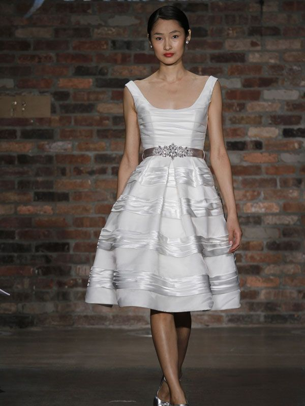 Fun and flirty vintage-inspired knee length wedding reception dress with lovely ribbon sash