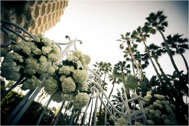 Four Seasons Beverly Hills- outdoor terrace for wedding ceremony, with ivory wedding flowers galore