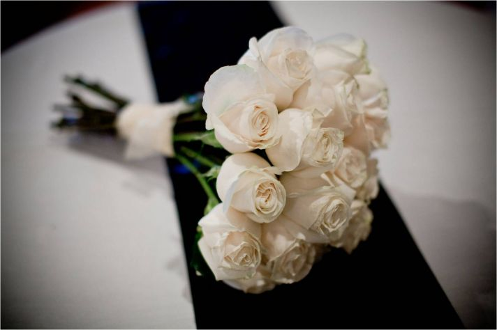 Chic, sophisticated bridal bouquet- all ivory long stemmed roses tied with ivory ribbon