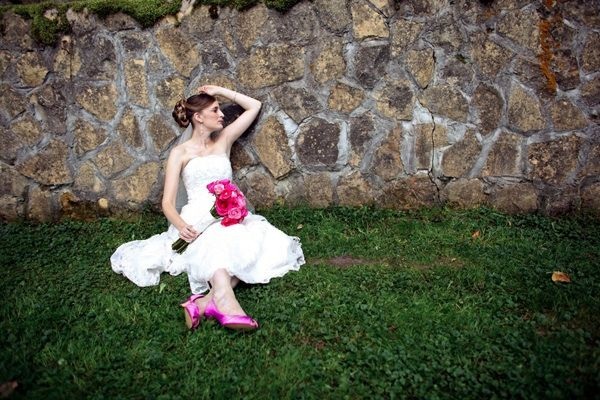 This bride's bright pink bouquet matches her bright pink shoes.