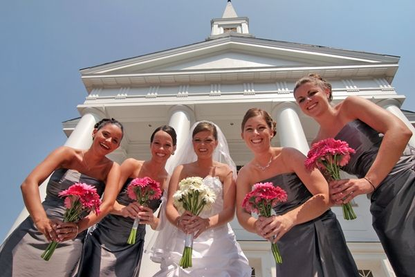 Maryland University bride in white strapless wedding dress poses with bridesmaids, ancient universit