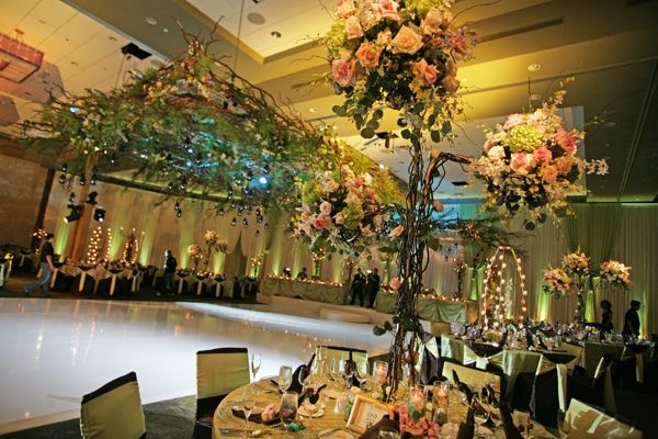 Opulent Chicago wedding reception decor with sky-high floral topiaries
