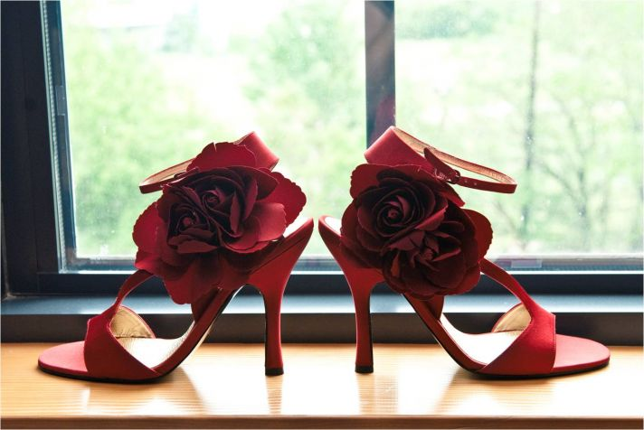 Sexy red satin open-toe bridal heels with rose detail on straps