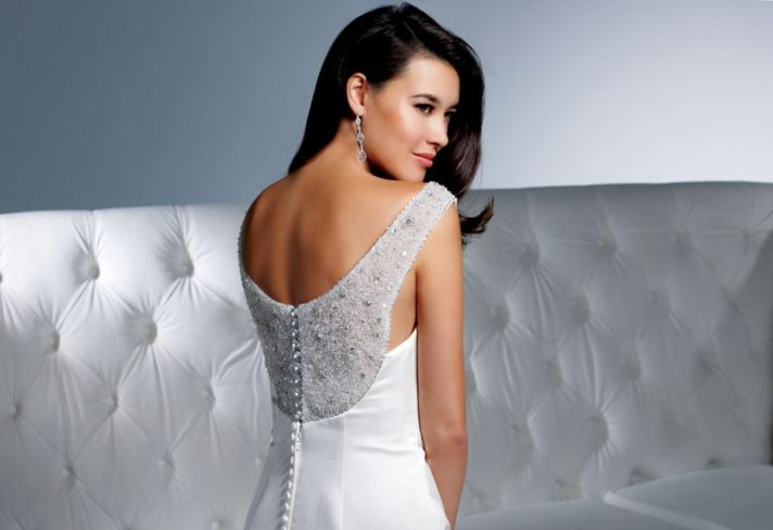 Timeless white wedding dress inspired by Audrey Hepburn, with beaded back