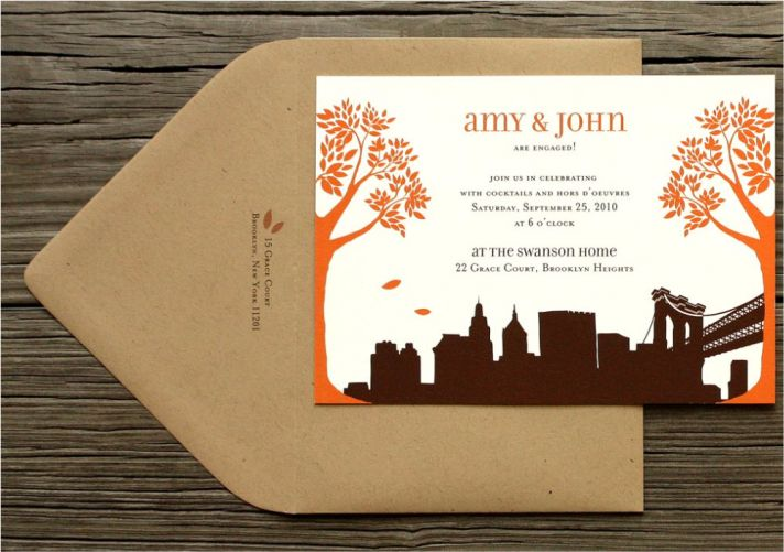 Chic white, orange, and chocolate brown fall wedding invitations with city skyline design