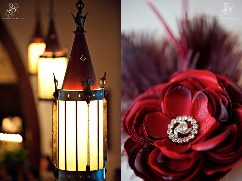 Deep red roses with feathers and romantic lanterns for chic wedding