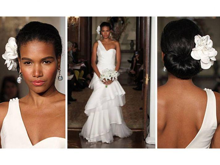 White one-shoulder 2011 Carolina Herrera wedding dress and white flower hair accessory